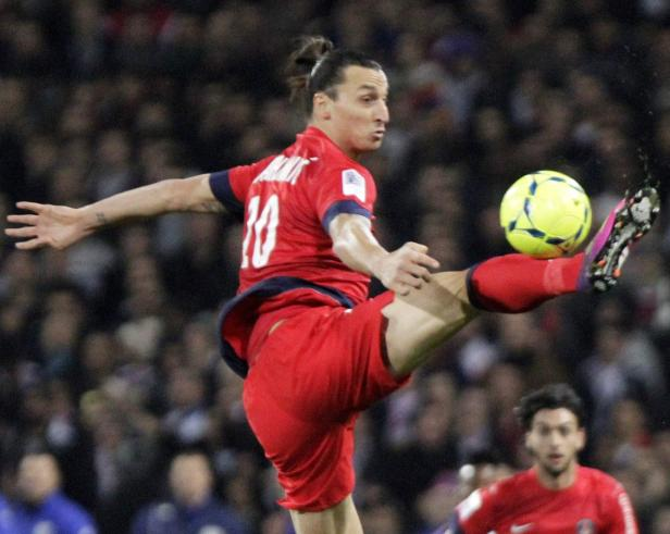 Paris Saint-Germain's Zlatan Ibrahimovic kicks the