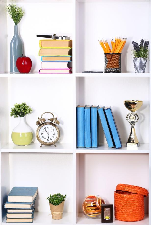 Beautiful white shelves with different home relate…