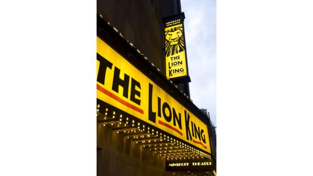 """dapdFILE - In this Jan. 19, 2012 file photo, the Minskoff Theatre and the marquee for """"The Lion King"""" are seen in New York. Box office revenues show that """"The Lion King"""" has recently swiped the title of Broadways all-time highest grossing show from """"The P"""