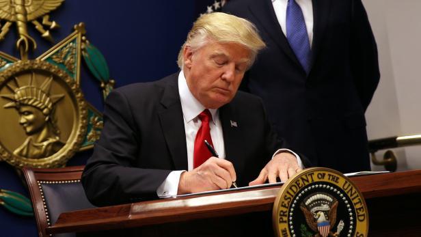 U.S. President Donald Trump signs an executive ord