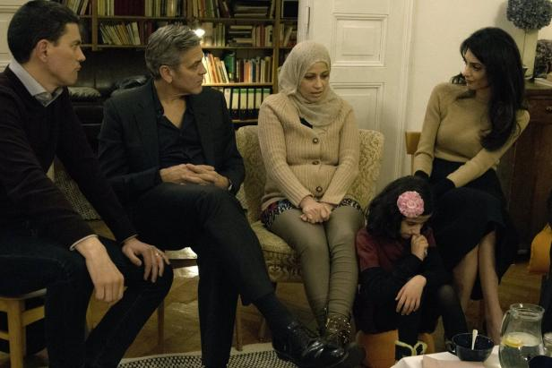Handout photo of Miliband, Clooney and Amal meetin