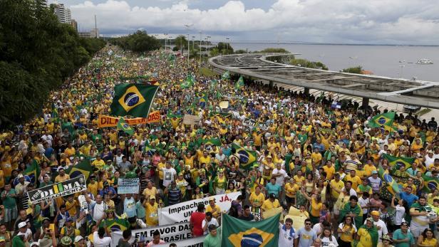 Demonstrators attend a protest against Brazil's Pr