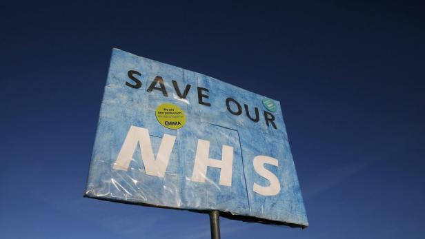 "File photo of a banner that reads ""Save Our NHS"""