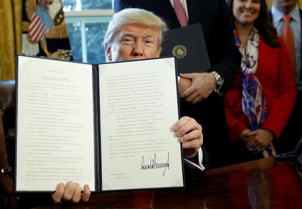 FILE PHOTO: Trump signs an executive order at the