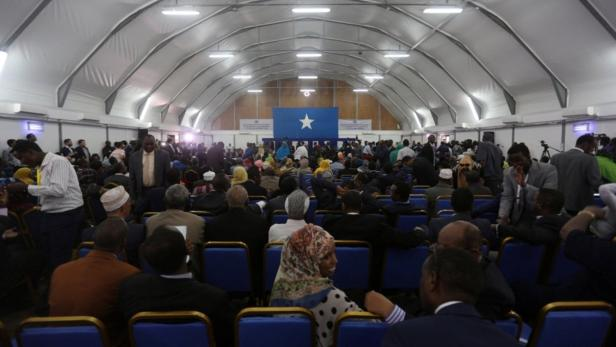 Somali lawmakers wait for their turn to cast their