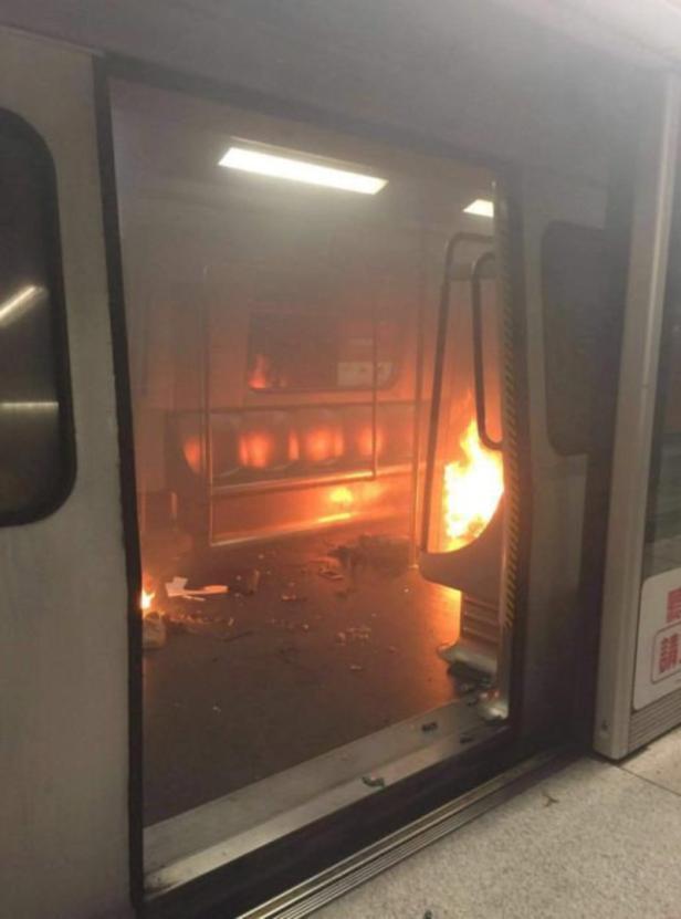A fire onboard a train is seen inside a subway sta