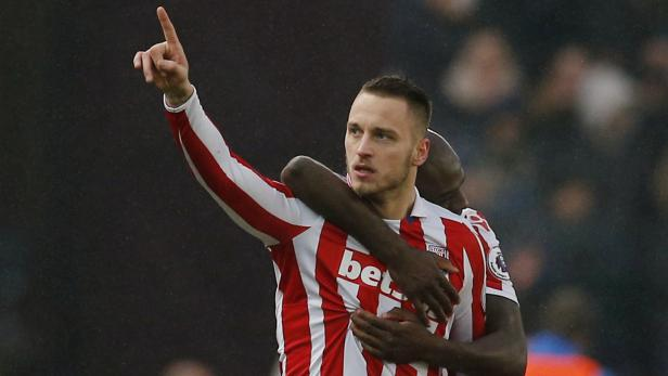Stoke City's Marko Arnautovic celebrates after Joe