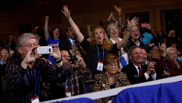 People cheer as Trump addresses CPAC in Oxon Hill,