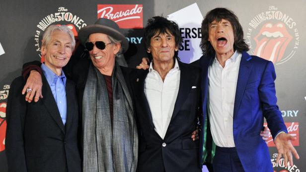 EPAepa03434314 (FILE) A file picture dated 12 July 2012 shows members of British rock band The Rolling Stones (L-R), Charlie Watts, Keith Richards, Ronnie Wood and Mick Jagger at the Rolling Stones Fifty Years exhibition at Somerset House in London, Brita