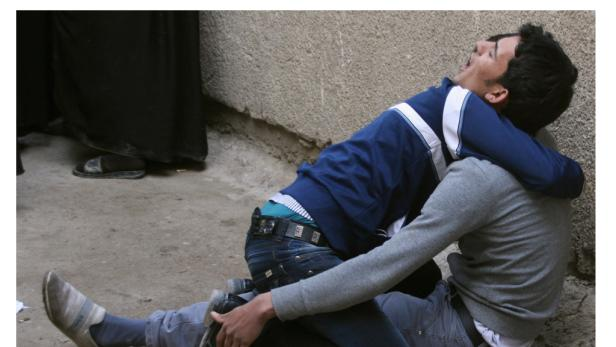 Trauernde Angehörige der Getöteten in Sadr City.