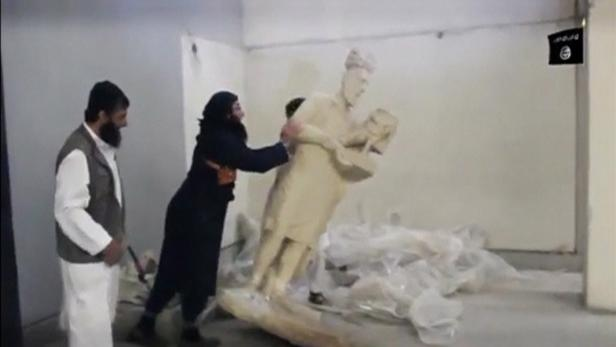 A man topples a statue in a museum at a location s
