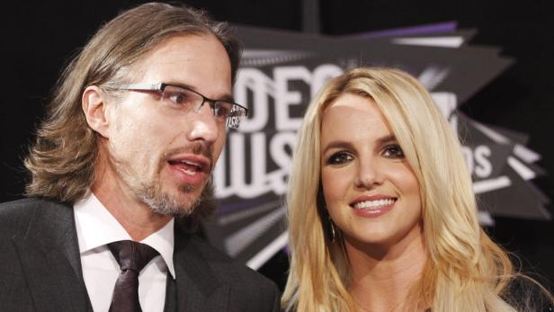 REUTERSSinger Britney Spears and boyfriend her Jason Trawick arrive at the 2011 MTV Video Music Awards in Los Angeles in this August 28, 2011 file photo. Celebrity media outlets reported the couple is engaged on December 16, 2011, after the singer posted