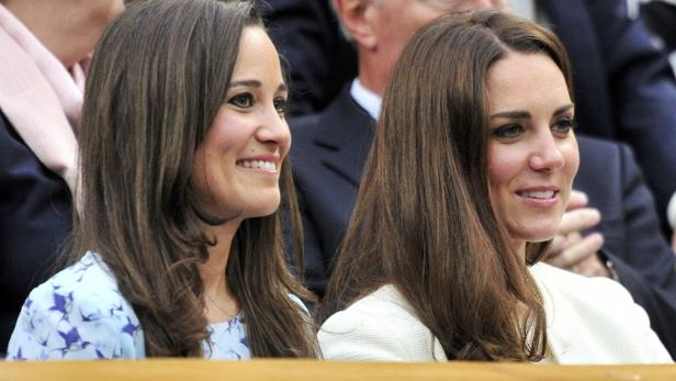 Britain's Catherine, Duchess of Cambridge sits wit