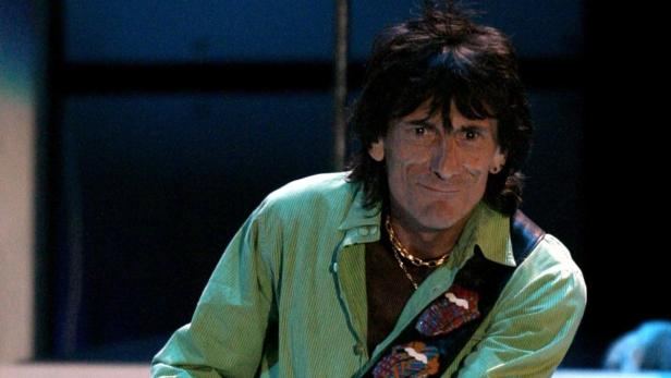 """For the first time in over a decade, singer Rod Stewart (not shown) and Rolling Stones guitarist Ron Wood perform on stage together since the time they use to be in the band called """"The Faces4; 34; They performed six songs together at the Hollywood Bowl i"""