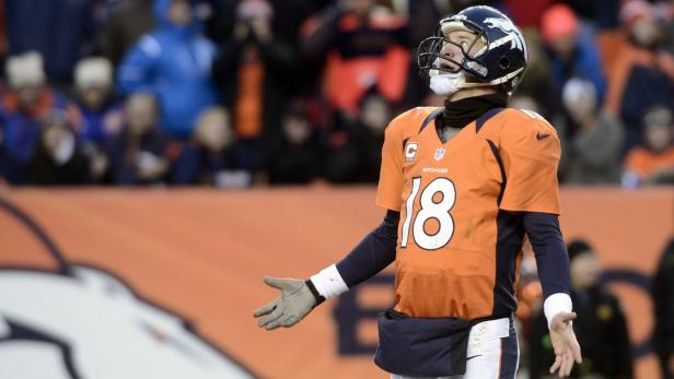 Broncos quarterback Manning reacts after the Bronc