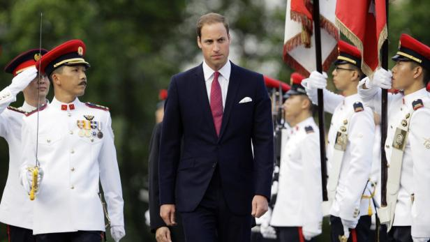 REUTERSBritains Prince William (C) inspects an honour guard during a welcoming ceremony at the Istana presidential palace in Singapore September 11, 2012. Prince William and Catherine, Duchess of Cambridge, are in the city-state for a three-day visit as p