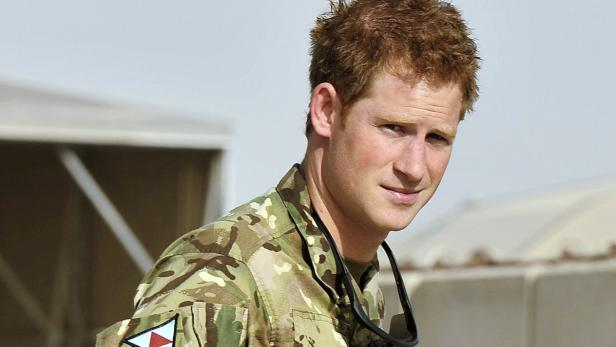 File picture shows Britain's Prince Harry gesturin