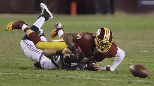 Seahawks quarterback Russell Wilson has the ball k