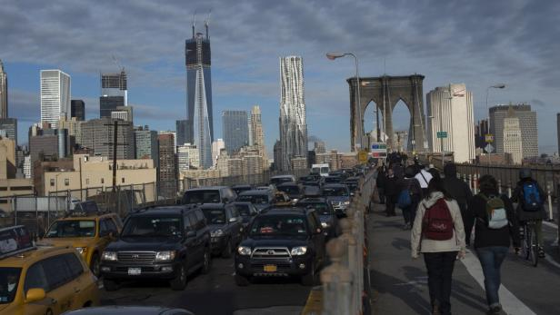REUTERSCommuters make their way across the Brooklyn Bridge in New York, October 31, 2012. Millions across the Northeast will attempt to resume their normal lives on Wednesday as companies, markets and airports reopen despite grim projections of power and