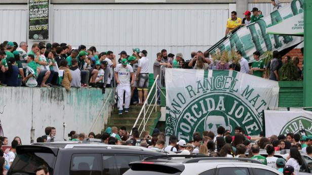 Fans of Chapecoense soccer team are pictured in fr