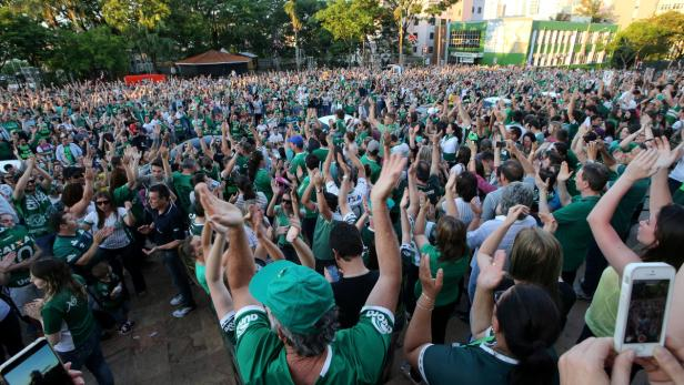 Fans of Chapecoense soccer team gather in the stre
