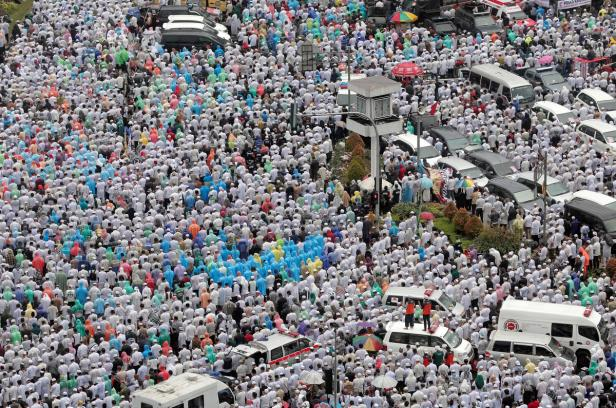 Indonesian Muslims pray at a rally calling for the