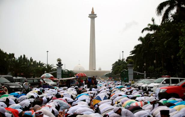 Indonesian Muslims attend Friday prayers during a