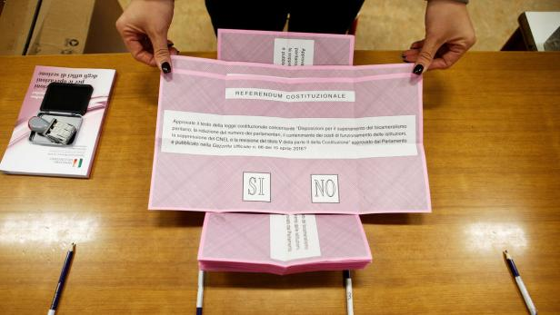Referendum ballots are seen at a polling station i