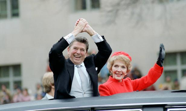 Ronald and Nancy Reagan waving from the limousine