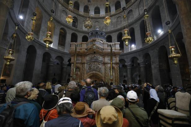 Visitors wait to enter the newly restored Edicule