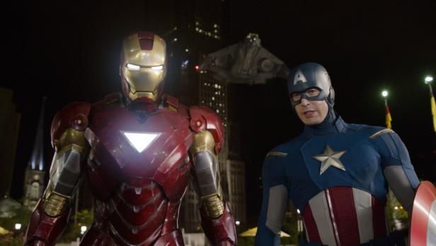 """dapdFILE - This file photo of a film image released by Disney shows Iron Man, portrayed by Robert Downey Jr., left, and Captain America, portrayed by Chris Evans, in a scene from """"The Avengers.""""  ey/Marvelvels """"The Avengers"""" sp doic box box office for a t"""