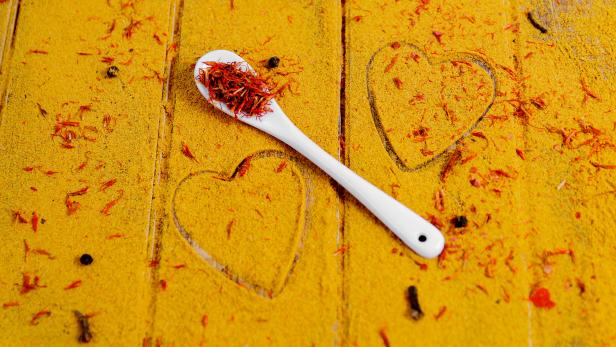 Heart of spices and seasonings. White spoon with s