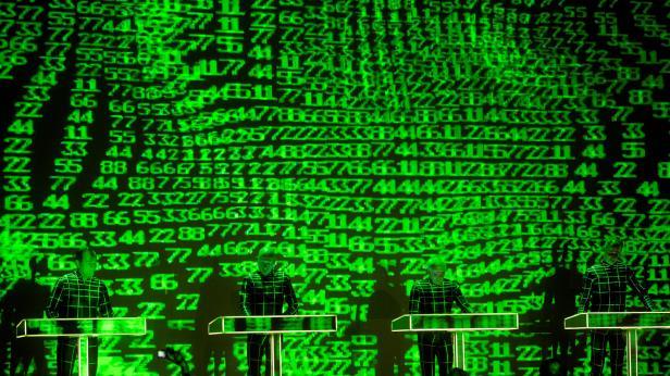 German electronic group Kraftwerk play on the firs