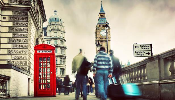 Red telephone booth and Big Ben in London, England…