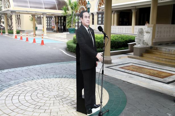 A cardboard cut-out of Thailand's Prime Minster Pr