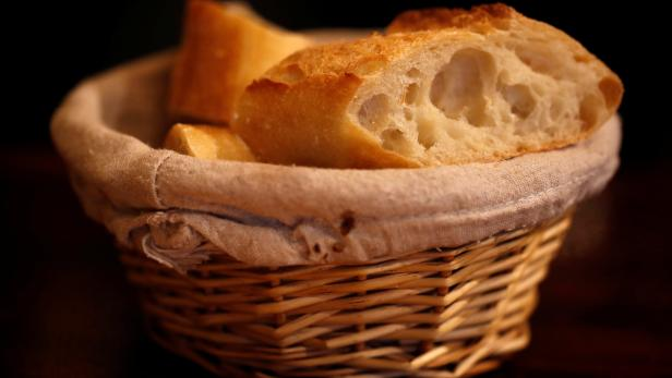Pieces of French baguette are seen in a bread bask