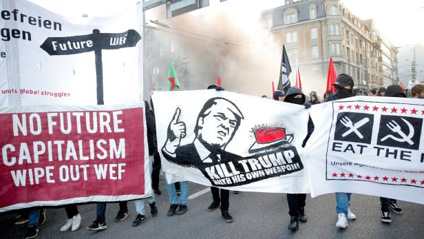 Protesters with banners march during an anti-WEF a