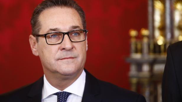 Head of the Freedom Party Strache reacts during th