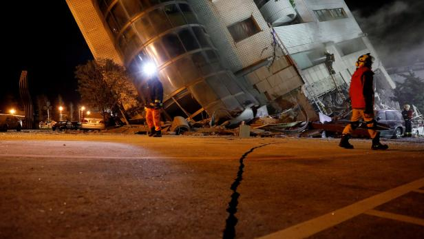 Rescue personnel search a collapses building after