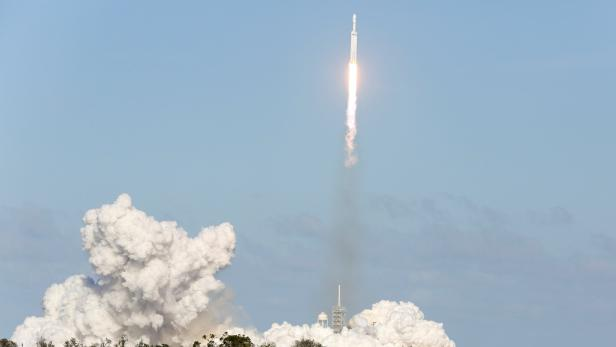 A SpaceX Falcon Heavy rocket lifts off from the Ke