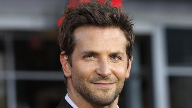 """REUTERSREFILE - CORRECTING TYPOCast member Bradley Cooper poses at the premiere of """"The Hangover Part II"""" at Graumans Chinese theatre in Hollywood, California in this  May 19, 2011 file photograph. Cooper was named People Magazines Sexiest Man Alive 2011"""