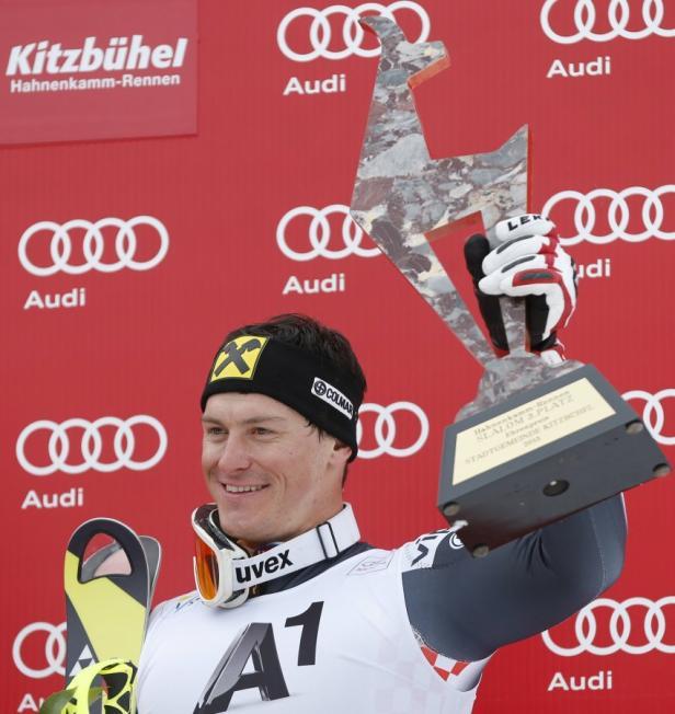 Kostelic of Croatia reacts on the podium holding t