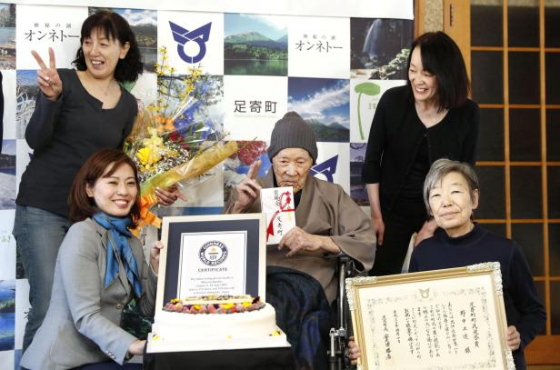 Japanese Masazo Nonaka poses for a photograph as he receives a Guinness World Records certificate naming him the world's oldest man during a ceremony in Ashoro