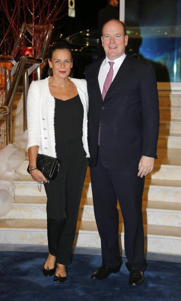 Monaco's Princess Stephanie poses with her brother Prince Albert II before an auction to raise funds for Fight Aids Monaco on World AIDS Day in Monaco
