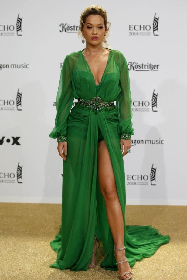 British singer Rita Ora poses during a photocall upon arrival for the 2018 Echo Music Award ceremony in Berlin