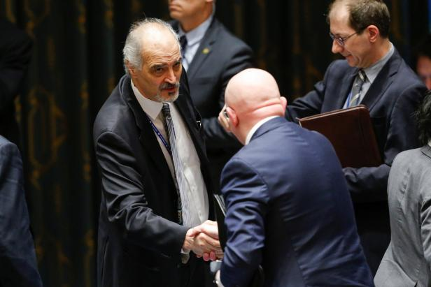 Jaafari, permanent Representative of the Syrian Arab Republic to the U.N. shakes hands with Russian Ambassador to the U.N. Nebenzya at the end of the emergency United Nations Security Council meeting on Syria at the U.N. headquarters in New York