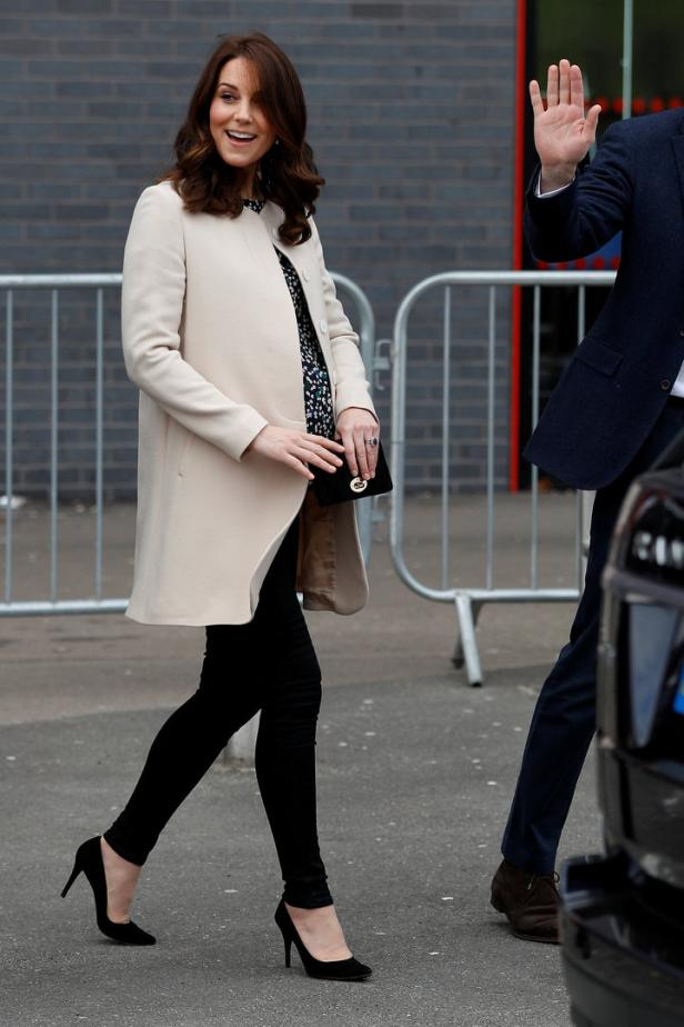 Britain's Prince William and Catherine, Duchess of Cambridge, wave as they leave a SportsAid event at the Copper Box in the Olympic Park in Stratford, London