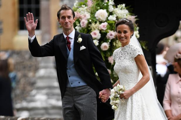FILE PHOTO: Pippa Middleton and her new husband James Matthews smile following their wedding ceremony at St Mark's Church in Englefield