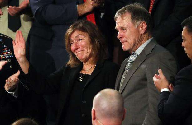 Otto Warmbier's parents cry as U.S. President Trump delivers his State of the Union address in Washington