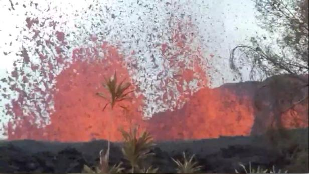 Lava is seen from a fissure appearing behind a resident's backyard in Puna, Hawaii, U.S. in this still frame taken from May 6, 2018 video obtained from social media.